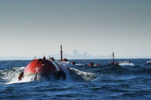 Wavs roll over the Pelamis Wave Converters, generating electricity