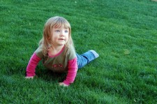 Child in the grass, photo by Az Jade, flickr