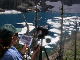 Researcher taking updated GPS readings to measure changes in the glacier
