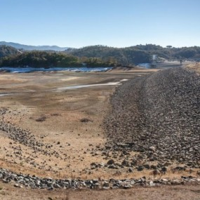Lake Mendocino, one of northern California's iconic blue lakes, now largely a dry lakebed due to drought