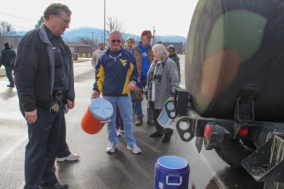 Customers stand in line to get recycled water