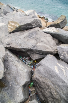Plastic fills crevasses on our beaches, photo-by Peter Charaf, courtesy of Race For Water Foundation